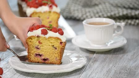 pumpkin pieces : A Slice of Summer Pound Cake with Raspberries Topped with Sugar Glaze.