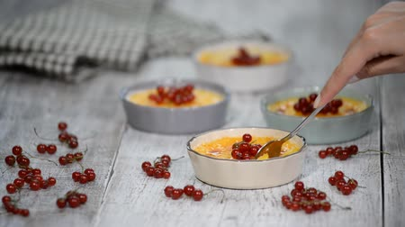 brulee : Creme brulee - traditional french vanilla cream dessert with caramelised sugar on top. Stock Footage