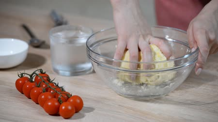 quiche : Kneading of short pastry with hands. Female hands make dough Stock Footage