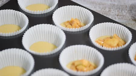 ralado : Cooking cupcake from dough with apples. Cooking process.