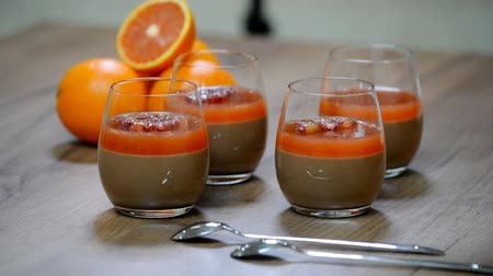 amargo : Delicious Italian dessert chocolate Panna Cotta with orange. Stock Footage