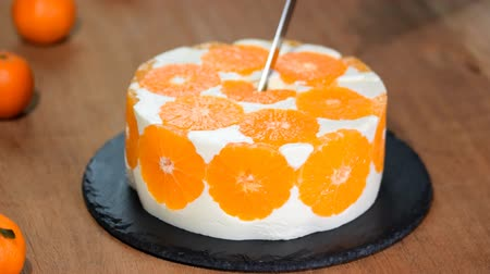exotic dishes : Cutting the Orange Mousse Cake.