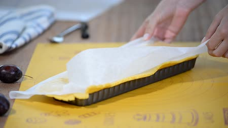 baking dishes : Putting the dough into a tart baking shape. Stock Footage