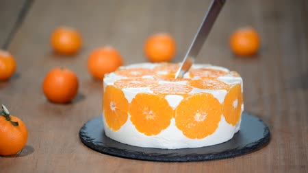cheese piece : Cutting the Orange Mousse Cake. Homemade mandarine mousse cake. Stock Footage