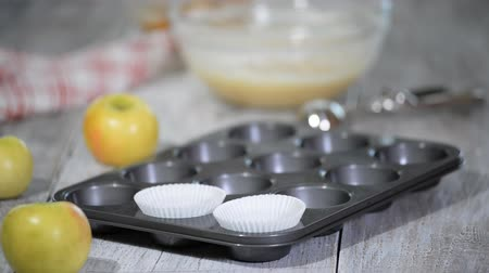 sarıcı : Empty paper forms for muffins and cupcakes in a metal tray.