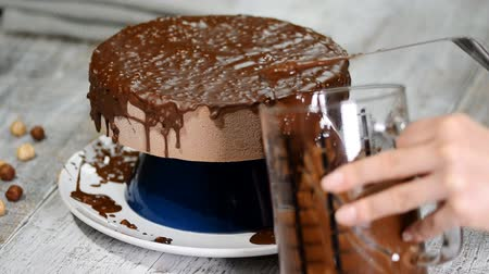 застекленный : The chocolate icing on the froasted cake.Modern French mousse cake with chocolate glaze.