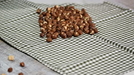 soyulmuş : Womens hands peel the hazelnuts.