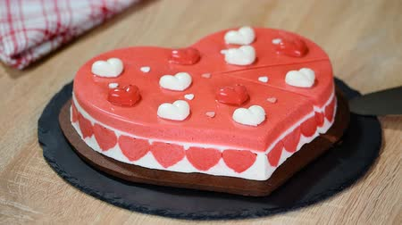 temp : Delicious mousse cake in the shape of a heart. Cake for Valentines day.