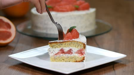 dips : Eat a piece of grapefruit cake Stock Footage