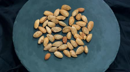 kernels : Almond closeup. Rotating nuts background, nobody.
