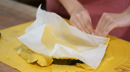 baking dishes : Press the pastry over the base and up the sides. Making Tart Series. Stock Footage