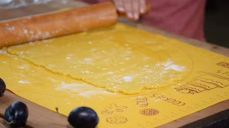 baking ingredient : Womans hands roll the dough. Woman making pie at home