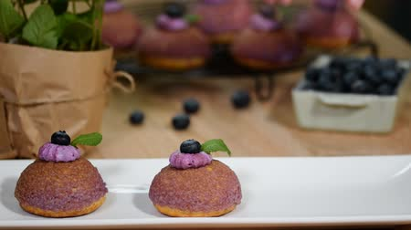 puffs : Cream puff choux dessert with blueberries