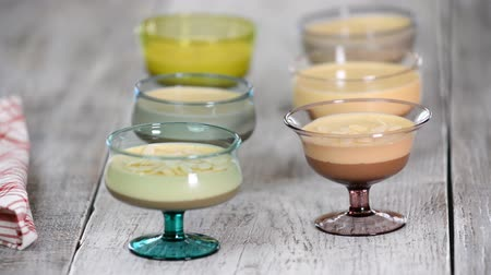 bolo de queijo : Sprinkle mousse dessert in glasses with almond petals Stock Footage