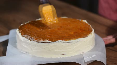 grated : Preparation of cake, spreading of apricot jam on cake. Stock Footage