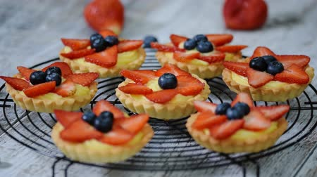 blueberry cheesecake : Summer berry tartlets with cream and fresh berries.