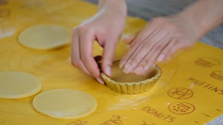 tartlet : Pastry chef making tartlets, putting the dough in baking dishes Stock Footage