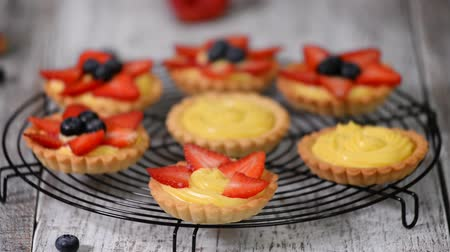 tartlet : Summer berry tartlets with cream and fresh berries.