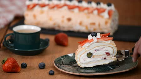 pavlova : Meringue Cake Roll Slice On A Plate With Berries. Anna Pavlova dessert.