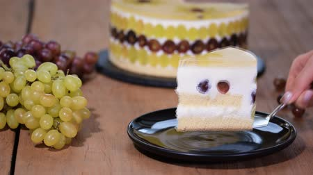 baked pudding : Piece of grape mousse cake. Creamy Yogurt Mousse Cake With Fruits. Stock Footage
