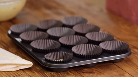 tray : The Process Of Preparing Cupcakes In The Kitchen.