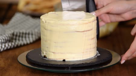 napoleon : Making layers of Napoleon cake at home. The process of making round layered napoleon cake with custard and sprinkled crumbs.