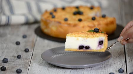 blueberry cheesecake : Piece of blueberry cheesecake on plate. Stock Footage