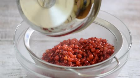 squeezer : Cooking Red Currant Jelly From Red Currants. Sweet Natural Homemade Sugar
