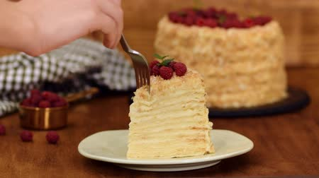свежесть : Slice Confectionery Napoleon Cake decorated with raspberry. Portion of Custard Cream Cake.