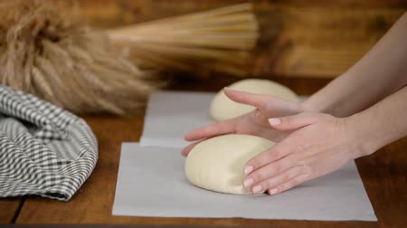pergament : Beker preparing bread for the oven.