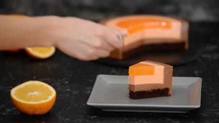 passievrucht : : Closeup of woman eating orange chocolate mousse cake.