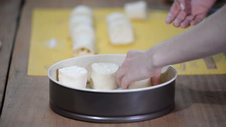 ón : Making of traditional yeast buns with cheese.