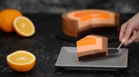 šlehačka : Piece of Orange Chocolate Mousse Cake.
