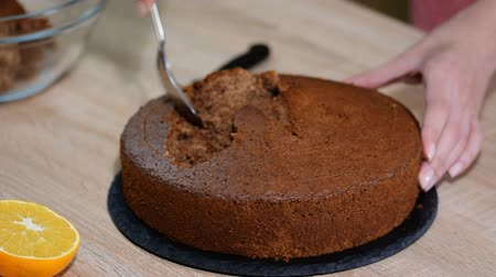 mink : Woman making at home Mink Mole Hole Cake.