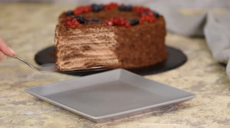 смородина : French Chocolate Napoleon cake of puff pastry with berries on a plate close-up. Стоковые видеозаписи