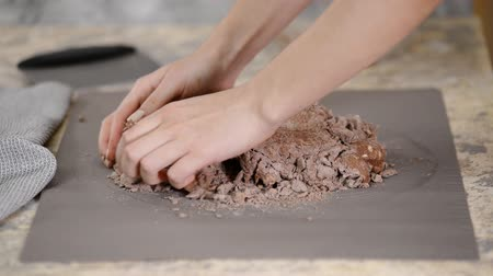 napoleon : Close up of female hands kneading raw chocolate dough at home for cake. Stock Footage
