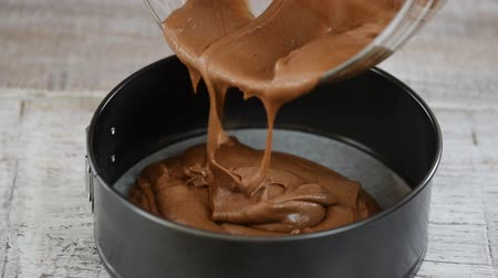 eklemek : Cake batter pouring into baking dish. Home baking concept. Stok Video