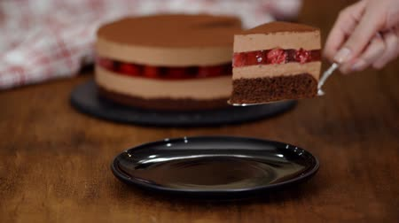 black raspberry : A piece of delicious chocolate mousse cake with raspberries jelly.