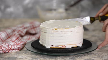 appetito : The process of making a cake. Chef making layer cake with cherry filling and sour cream. Series.