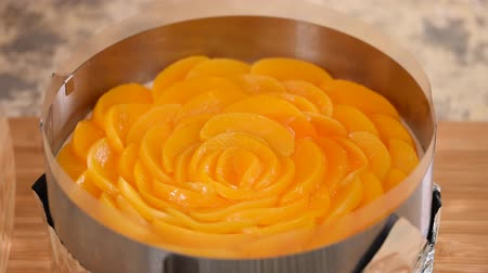 чизкейк : Pastry Chef Making Tasty Peach Jelly Cake.