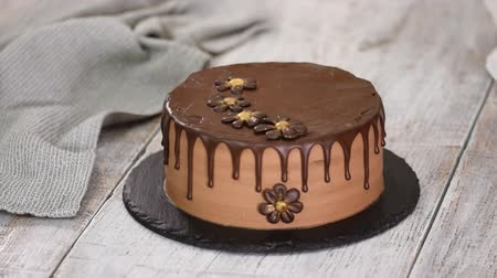 truffel : Confectioner-baker decorate beautiful cream cake with chocolate flowers.