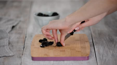 black berry : Chef Is Cutting Dried Prunes. Healthy eating concept.