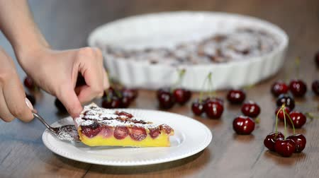 pite : Piece of sweet cherry clafouti. Summer pie. Stock mozgókép