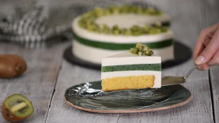 vanilya : Piece of homemade mousse cake with kiwi.