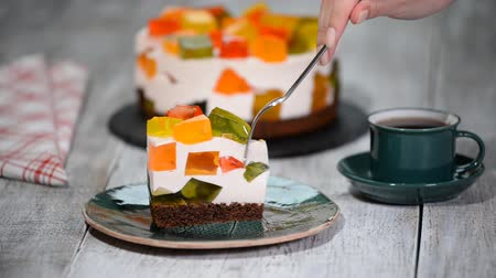 houten bord : Cake With Colored Jelly. A Piece Of Cake Broken Glass.