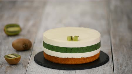 Chef Decorate The Cake With Fresh Kiwi. Homemade Mousse Cake With Kiwi.