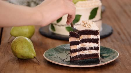 Eating A Piece Of Delicious Chocolate Cake With Pear Filling.