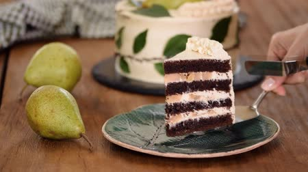 Piece Of Delicious Chocolate Cake With Pear Filling.