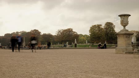 luxemburg : People walking in the luxembourg gardens in paris france during autumn time lapse