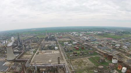 industrialization : Oil refinery with various petrochemical installations and fuel tank reservoirs aerial shot